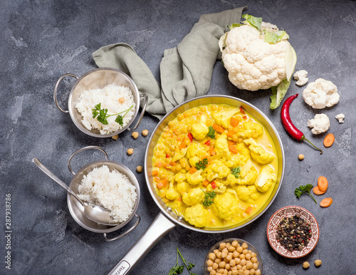 Vegetarian curry with cauliflower and chickpeas, healthy homemade vegan food, in Canvas Print