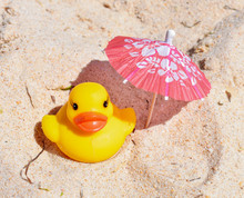 Rubber Duck On Beach Background