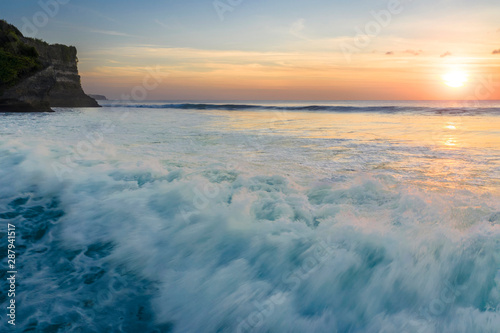 Poster Mer coucher du soleil Aerial view of big waves creating sea spray at sunset in the turquoise water, Bali, Indonesia