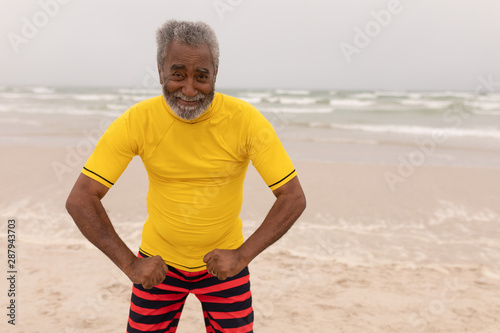 Senior man posing on the beach