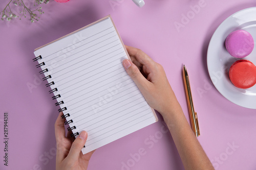 Woman holding a notebook during the afternoon tea