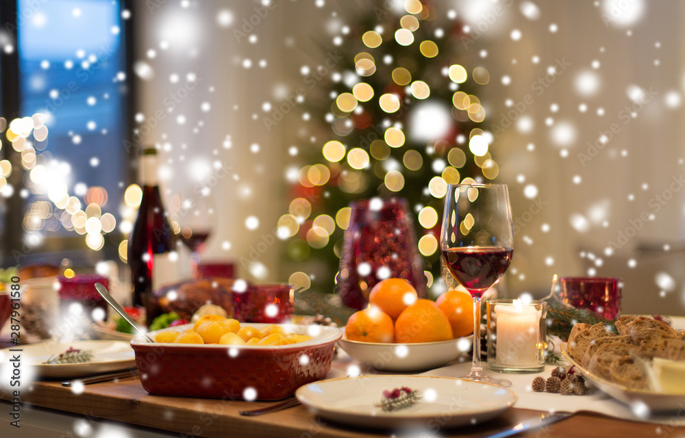Fototapety, obrazy: christmas dinner and eating concept - food and drinks on table at home over snow