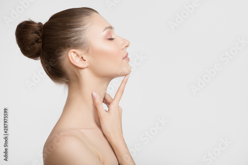 Portrait of a young woman. Bare shoulders. Hand touches face Fototapeta