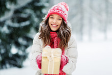 Christmas, Holidays And People Concept - Happy Teenage Girl Or Young Woman With Gift Box Outdoors Winter Park