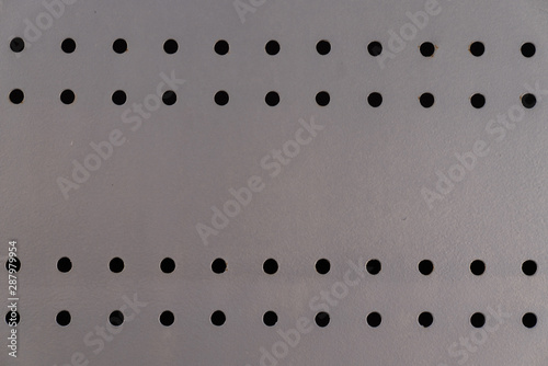 Fototapeta detail texture of steel metal plate with holes background obraz