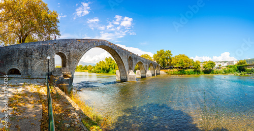 The Bridge of Arta is an old arched stone bridge that crosses the Arachthos river in the west of the city of Arta in Greece.