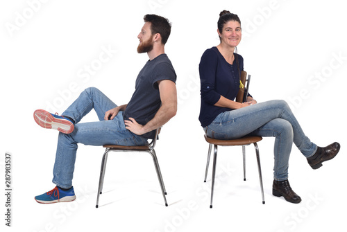 Fototapeta couple sitting in a vintage chair isolated on white obraz