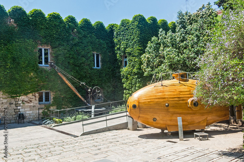 Garden Poster Narcissus Submarine at the courtyard of the Maritime Museum - Barcelona. A submarine on display at the Maritime Museum (Museu Maritim) in Barcelona, Spain