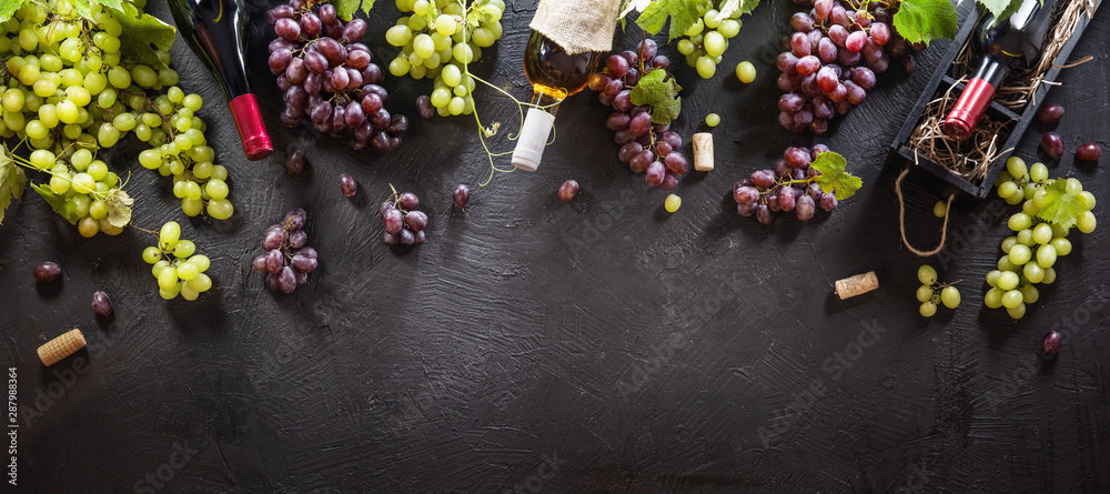 Fototapeta Red And White Grapes With Bottles On A Black Background. Top View