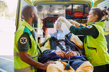 Paramedics Treating Patient Wi...
