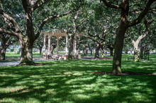 Sun-dappled View Of Classic Southern Gazebo Set Amongst A Canopy Of Oak Trees In White Point Garden Park In The Battery, Charleston, South Carolina, USA