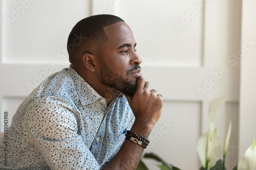 Close up happy calm young african american thoughtful guy. Tablou Canvas