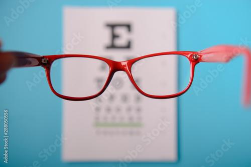 glasses lying on snellen test chart Canvas Print