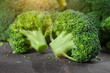 Leinwanddruck Bild Macro photo green fresh vegetable broccoli. Fresh green broccoli on a black stone table.Broccoli vegetable is full of vitamin.Vegetables for diet and healthy eating.Organic food.