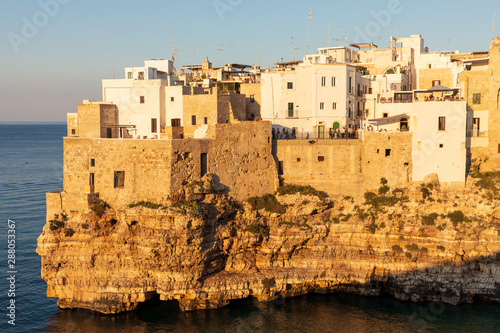Italy, Apulia, Metropolitan City of Bari, Polignano a Mare. View of part of the old town, built on cliffs over the Adriatic Sea.