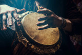 A man playing an ethnic percussion musical instrument jembe. Drummer playing african musicembe