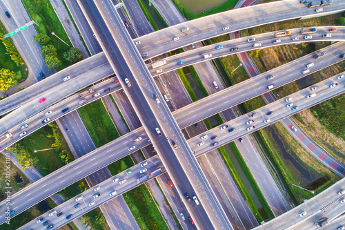 Aerial view transport junction road car movement with sunset light