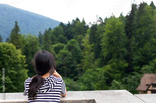 Obraz na plátně  Tourist baxck veiw