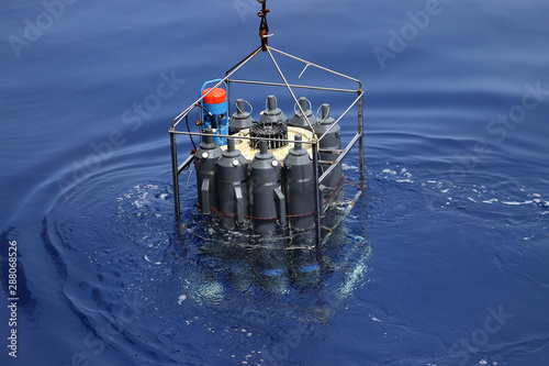 Fototapeta CTD rosette sampler with bathometers and other science equipment for measurement of underwater environment parameters like temperature, salinity and others