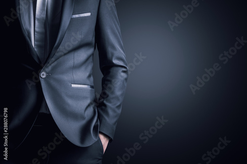 Business man in a suit on a gray background Canvas Print