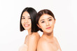 Portrait of two beautiful young asia women