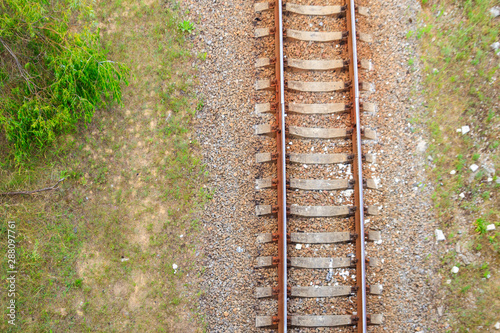 Recess Fitting Railroad Top view of railroad track through a green pine forest