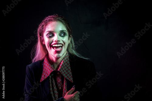Woman dressed as joker laughing hysterically Wallpaper Mural