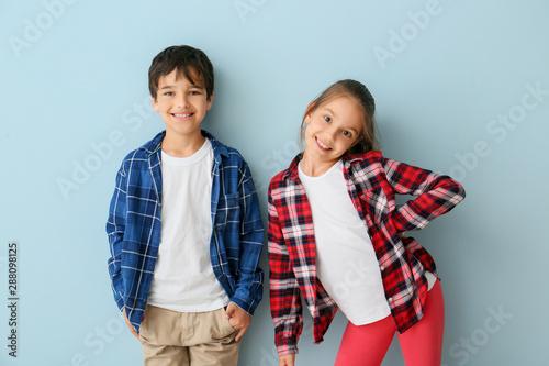 Obraz Portrait of cute children on color background - fototapety do salonu