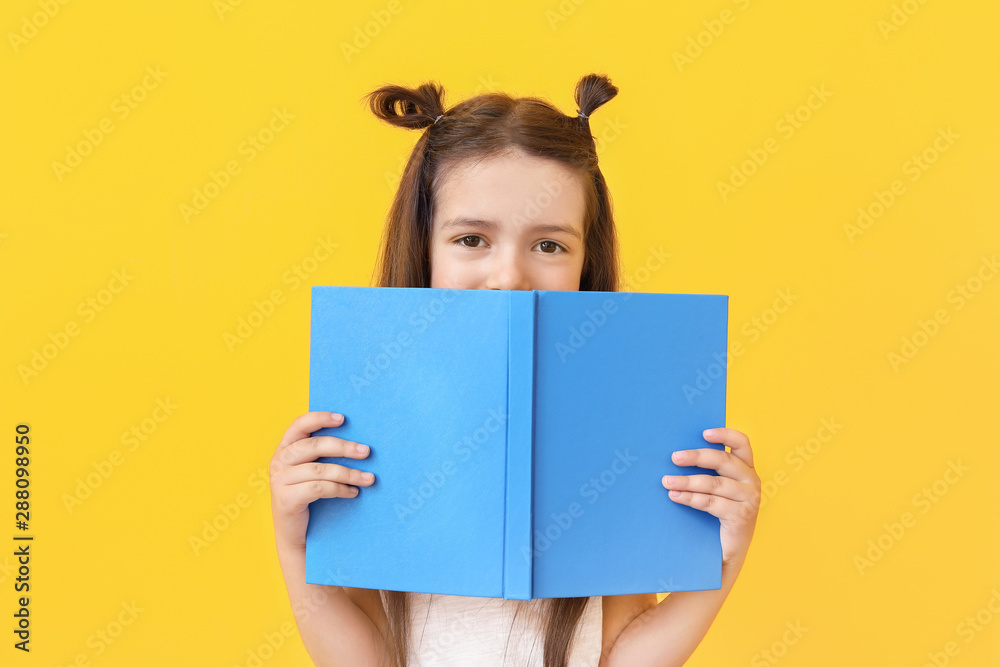 Fototapety, obrazy: Cute little girl with book on color background