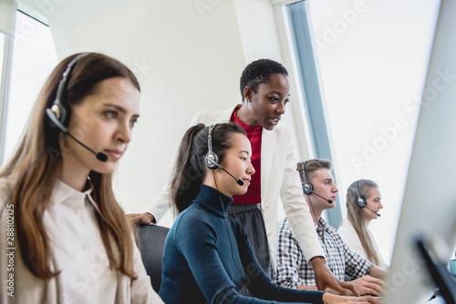 Fotografia Female supervisor working with team in call center