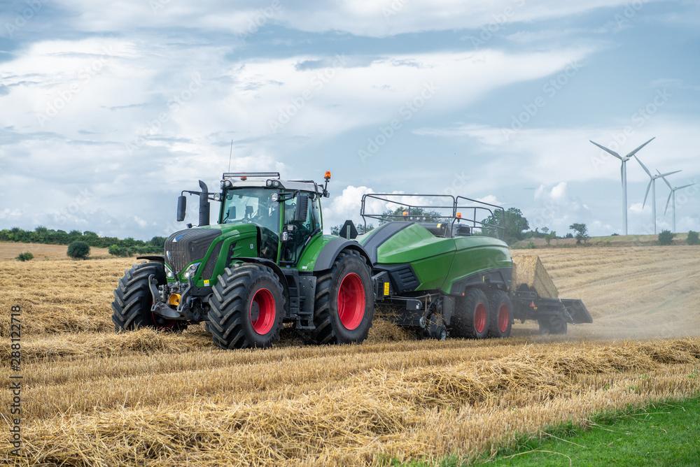 Fototapeta tractor working in field