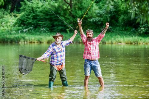Bearded men catching fish Canvas Print