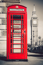 London's Iconic Telephone Booth With The Big Ben Clock Tower In The Background
