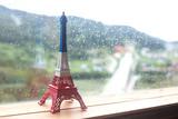 Fototapeta Fototapety z wieżą Eiffla - Eiffel tower miniature by the window. rainy day