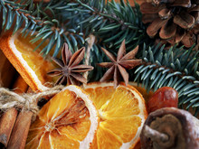 Christmas Holiday Composition : Beautiful Close-up Branches Of Spruce , Of Dry Oranges, Cinnamon Sticks And Star Anise, Dried Fruits, Fir Cones In  A Wooden Box.