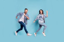 Full Length Body Size Photo Of Rejoicing Couple Of Friends Running Towards Shopping Mall For Sales While Isolated With Blue Background