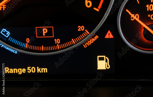 Fotografie, Obraz  Gas station icon flat display on dashboard in car on background.