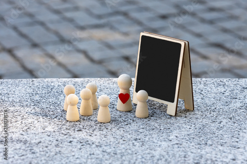 Photo concept, teacher and student at the blackboard, with people around