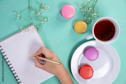 Woman writing during the afternoon tea