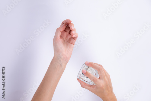 Woman testing perfume on her wrist