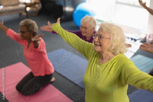 Senior people exercising in fitness studio