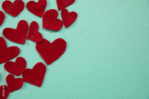Several hand made hearts made of felt