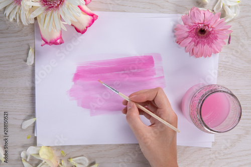 Woman painting a pink watercolor