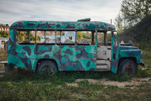 Old Abandoned Bus Green In The...