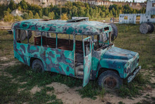 Old Abandoned Bus Green In The Field