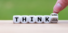 """Hand Turns A Dice And Changes The Expression """"think Local"""" To """"think Global"""""""