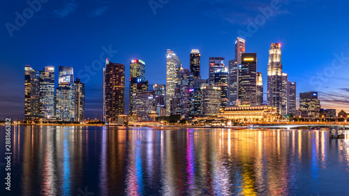 Marina bay,Singapore - 2017 September 21 : Singapore business building skyline at dawn with reflexion on waterbay in twilight time Wallpaper Mural