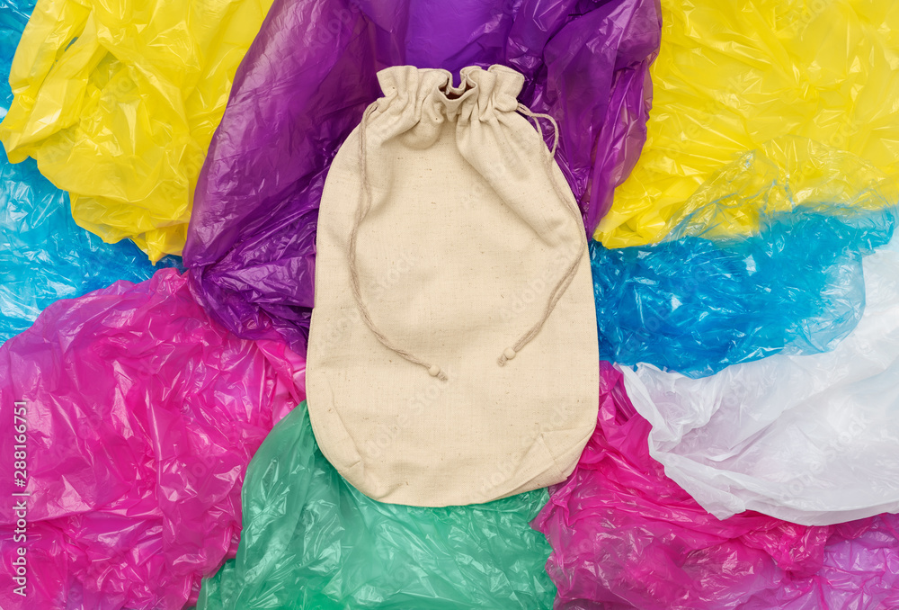 Fototapety, obrazy: Cotton sack on plastic bags