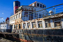A Derelict And Rusted Paddle S...