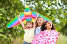 Little Girls Flying Kites Outd...